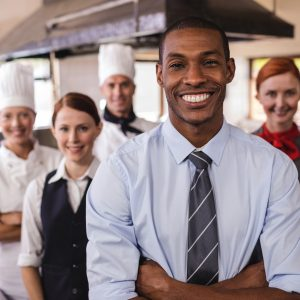 Meal delivery business owner with kitchen staff